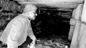 Director of Archaeology and Museums Dr. R. Gopal inspecting the tunnel discovered recently at the Gajendra Moksha kalyani near the Ranganathaswami temple in Srirangapatna.
